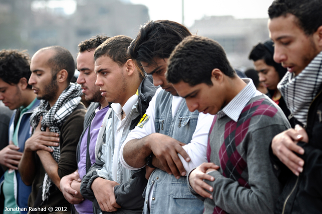 Egyptian protesters praying, photo taken by Jonathan Rashad.