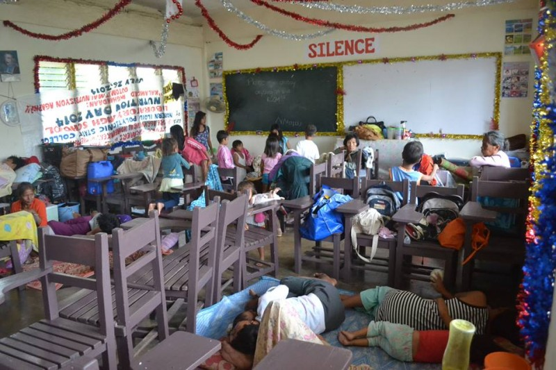 Fearing that a coming storm will be as strong as Haiyan, residents readily troop into a school which was temporarily converted into an evacuation center.