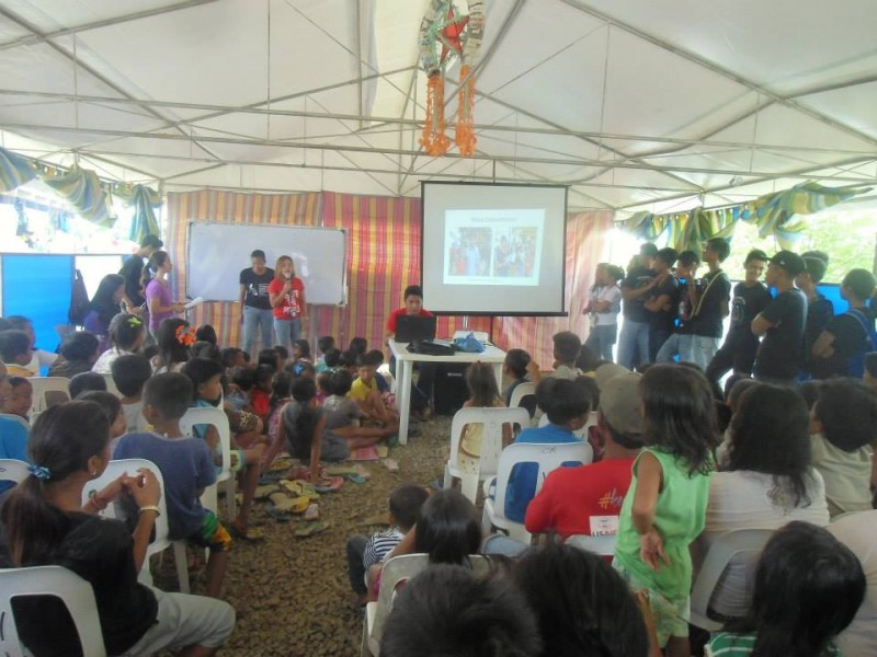 A community outreach involves cultural performances, discussion of climate change impact, and feeding sessions.