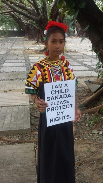 "Pitang holding a placard which reads: ""I am a child laborer"". Photo from Facebook page of Jhona Ignilan Stokes"