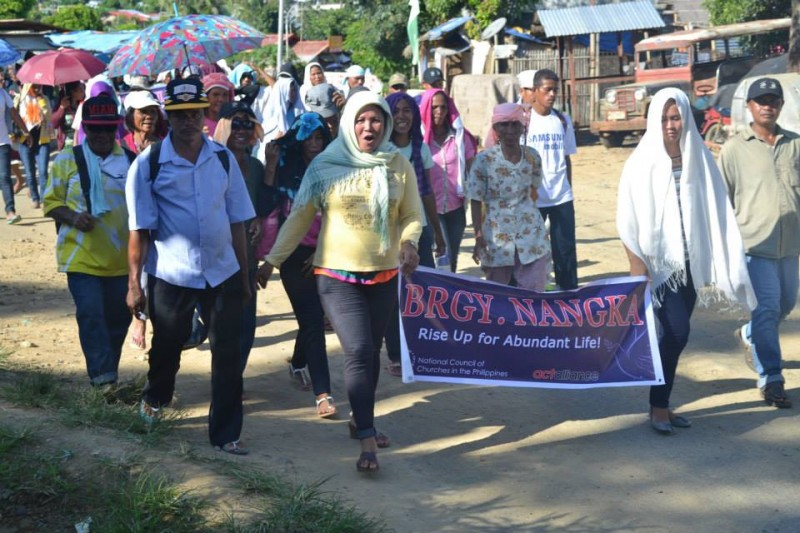 During the 'walk for justice', residents carried banners which read 'rise up for abundant life'.