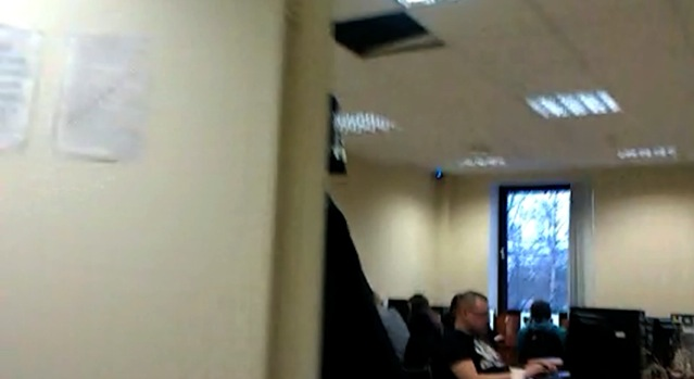 "A rare glimpse inside the ""troll army headquarters"" of Savushkina 55. Screencap from a video posted by Andrei Soshnikov to YouTube."