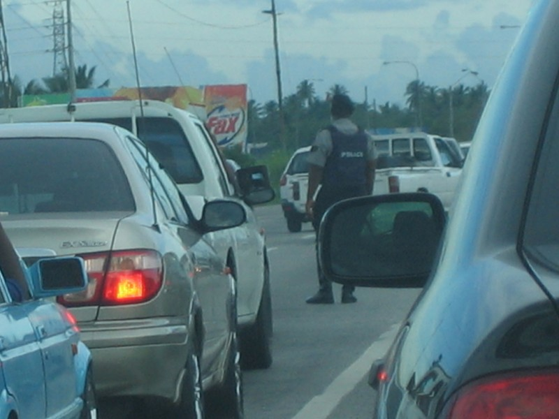 """""""Directing Traffic in bulletproof vests""""; photo by Taran Rampersad,  used under a CC BY-NC-ND 2.0 license."""
