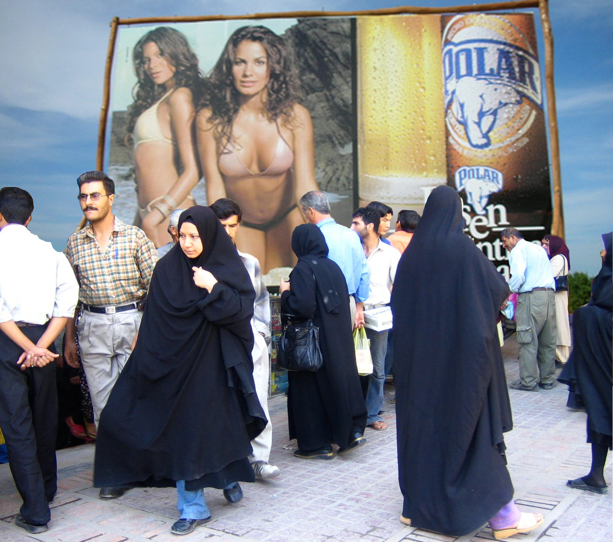 "Bikinis vs Chadors in Venezuela and Iran: ""After acclimatizing to Venezuela, even some of the Iranian women would adopt the more revealing dress style of their Venezuelan peers."" Shiraz street scene photo by Flickr user Gabriel White (CC BY-SA 2.0). Images remixed by Georgia Popplewell."