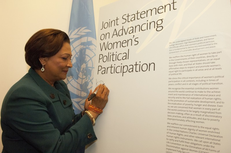 In what must now seem quite ironic, Trinidad & Tobago's Prime Minister, Kamla Persad-Bissessar, signs a Joint Statement on Advancing Women's Political Participation. Photo Credit: UN Women/Catianne Tijerina, used under a CC BY-NC-ND 2.0 license.