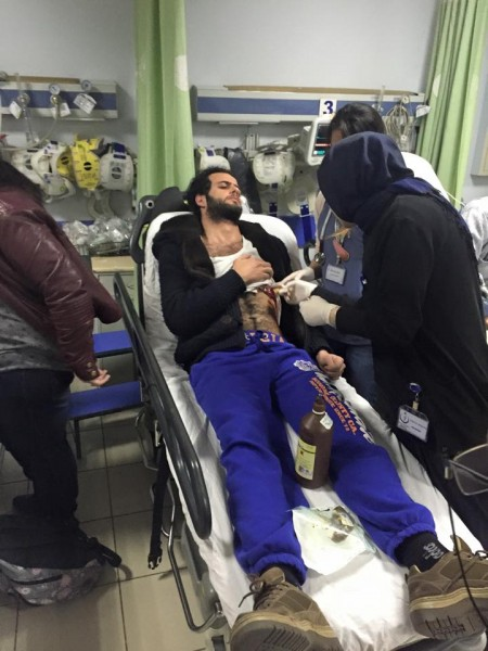 Blogger Asaad Hanna receiving treatment at an Istanbul hospital after being stabbed in his home earlier today. Photo credit: Asaad Hanna's Facebook page