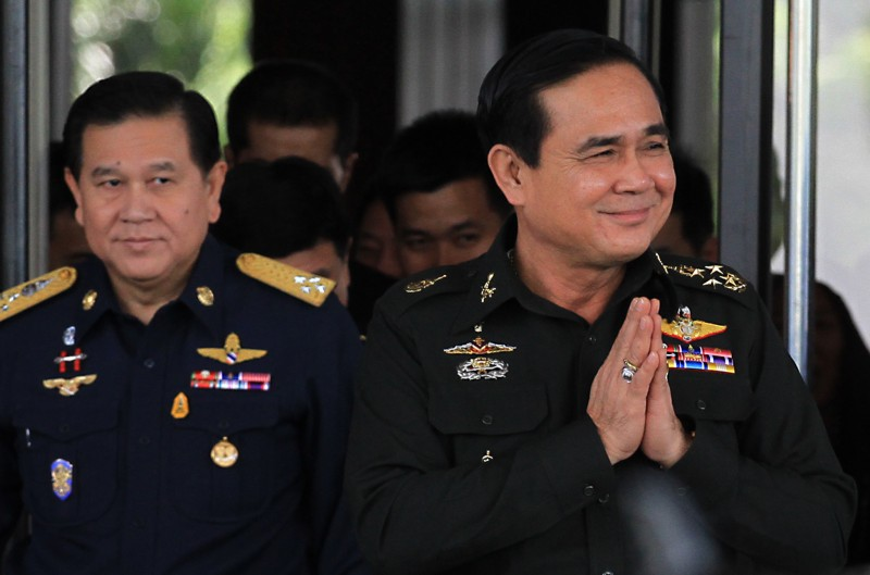 File photo of General Prayuth Chan-ocha (right), the incumbent Prime Minister of Thailand. Prayuth signed a new security law to replace martial law in the country. Photo by Vichan Poti, Copyright @Demotix (9/4/2014)