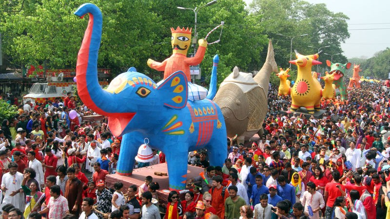Crowds celebrated Pahela Baishakh at Mangal Shobhajatra, a procession organised by Dhaka University's Faculty of Fine Arts to welcome the Bengali New Year 1422. Image by Sk. Hasan Ali. Copyright Demotix (14/4/2015)