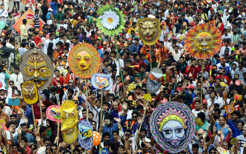 People celebrating Pahela Baishakh at Mangal Shobhajatra (Rally), a procession organised by Dhaka University's Faculty of Fine Arts to welcome the Bengali new year. Image by Sourav Lasker. Copyright Demotix (14/4/2015)