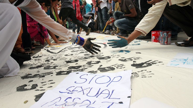 Students create a banner with black handprints as they rally around Dhaka University to protest incidents of sexual harassment on the campus during Bengali New Year celebrations. Image by Sk. Hasan Ali. Copyright Demotix (20/4/2015)