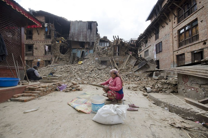 This woman was separating dust particles and small pebbles from rice grains as a 7.8-magnitude quake hit Nepal on Saturday and destroyed her house along with the remaining food supplies their family had. Bungamati village, about 8 kilometres south of Kathmandu. Image by Sumit Shrestha. Copyright Demotix (27/4/2015)