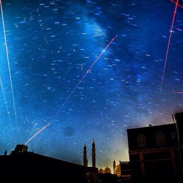"""Picturesque scene of Sana'a until you realize those are anti aircraft weapons zipping through the sky. #Yemen"" tweets Yemeni blogger @amalscript, who shares this photograph on Twitter"