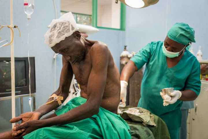A patient is prepped for surgery to repair a hernia at the Hospital Rural de Chokwe. Before Mozambique began training non-doctors to do surgery, according to the former Health Minister, people were dying from things like miscarriages or getting shot in the leg. Credit: Bridget Huber. Published with PRI's permission
