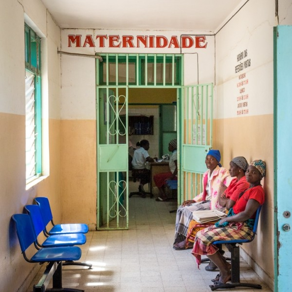 Waiting outside the maternity ward at the hospital in Chokwe. Credit: Bridget Huber. Published with PRI's permission