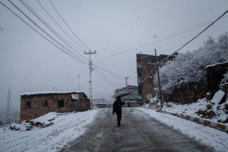 A man walks through the snow covered streets of the old part of the town of Kocaköy, Diyarbakir province, Turkey. Credit: Bradley Secker. Published with PRI's permission.