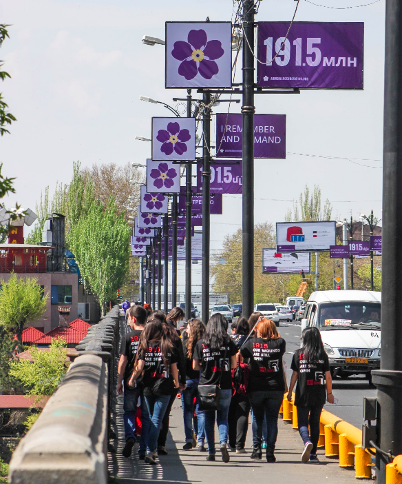 Armenian students walking towards Genocide Museum, surrounded by the Centennial emblem. Photo taken by myself.
