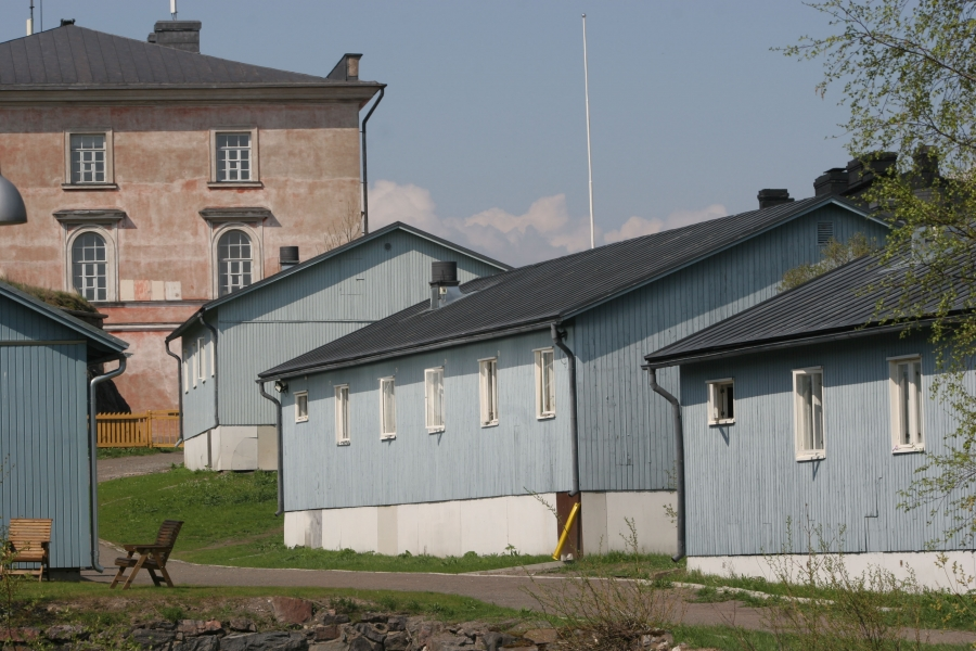 Inmates at the Suomenlinna open prison live in blue dormitory-style housing. A picket fence is all that separates the prison grounds from the rest of the island, a popular tourist destination. Credit: Courtesy of Criminal Sanctions Agency, Finland