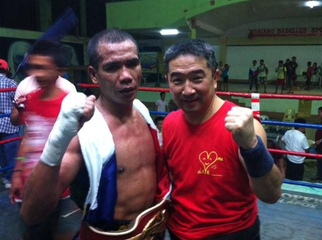 Japanese trainor Eiji Yoshikawa (right) and Cirilo Espino (left) who won a boxing championship in Mindanao Island in the Philippines