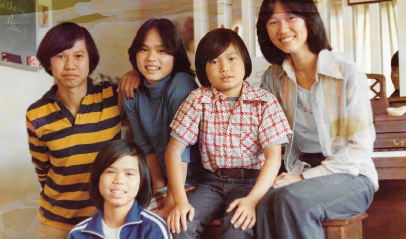 The Truong family arrived to the United States not long after fleeing Vietnam in 1975, when the then-capital of South Vietnam, Saigon, fell to the North Vietnamese army. Thu-Thuy Truong, far right, places bunny ears above her brother, Sy. Credit: Courtesy of Thu-Thuy Truong. Published with PRI's permission