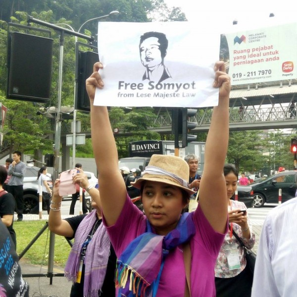 An activist holding a placard in support of Somyot Prueksakasemsuk, a Thai journalist who was charged with Lese Majeste (anti-Royal Insult law). His case is an example of the free speech restriction in Thailand. Photo from ASEAN Peoples' Forum