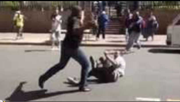 A screenshot of a YouTube video posted by Ren TV showing an attack on an Ethiopian national.
