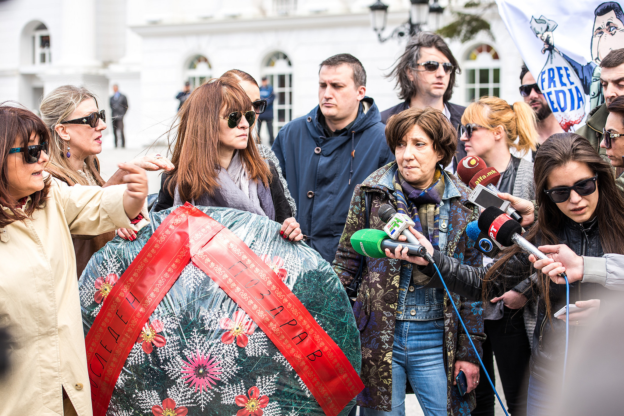 Several journalists spoke at a protest in Skopje about the recent threats directed at journalist Borjan Jovanovski, holding the funeral wreath that had been delivered to his home as a death threat in April 2015. Photo by Vanco Dzambaski, used with permission.