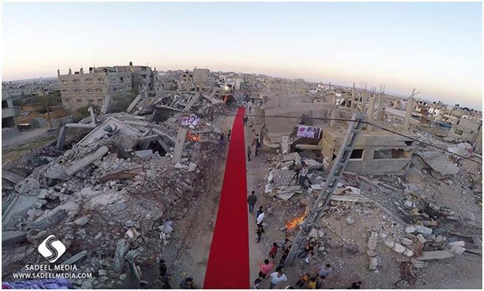 The red carpet is rolled out, surrounded by the destruction wrought upon Gaza (Source: Karam Gaza Film Festival Facebook Page)