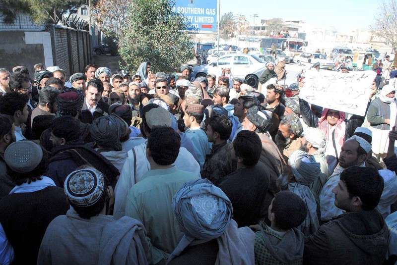 Quetta, Pakistan. 12 December 2011 -- Residents of Pasthoonbagh Nechari road gather at Sui Southern Gas Company office to protest against low pressure of Sui gas in their area in Quetta. Photo by ppiimages. Copyright Demotix