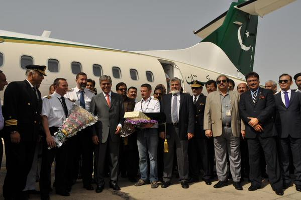 PIA's staff posing for a picture in front of a newly acquired ATR-72. A small plane that carries 72 passengers, which has been assigned to most routes in Balochistan.  Image tweeted by @Official_PIA on April 10, 2015.