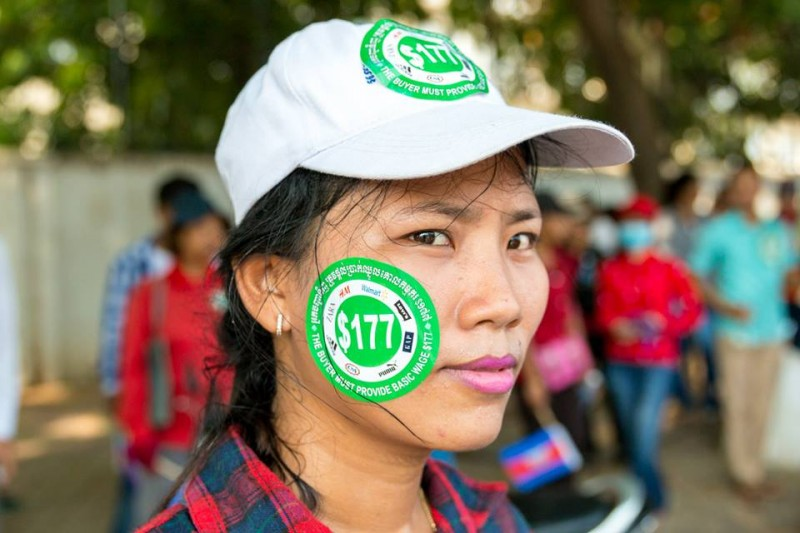 A worker wearing a sticker that features the logos of major apparel brands, including H&M, Walmart, Levi's, Gap Puma, C&A, Adidas and Zara, that outsource their production in factories in Cambodia. Photo from the Facebook page of Licadho, a human rights group