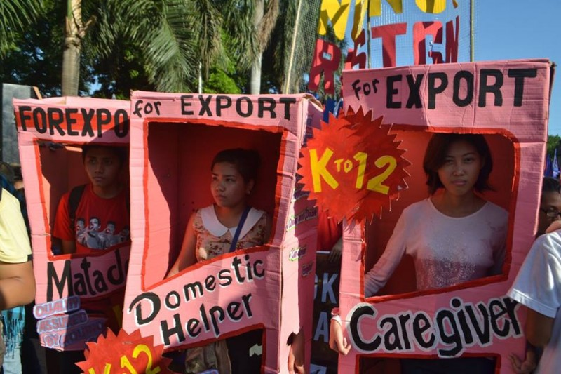 Activists decry the Philippines' labor export policy. Photo from the Facebook page of Mykel Andrada