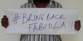 An Unidentified Person Holds Plackard asking NTV to Bring Back Fabiola.