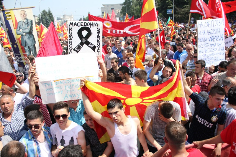 Skopje, Macedonia. 17th May 2015 -- Tens of thousands of protesters take to the streets of Macedonia's capital on Sunday, waving Macedonian and Albanian flags and calling for the government to resign. Photo by Aitor Sáez. Copyright Demotix