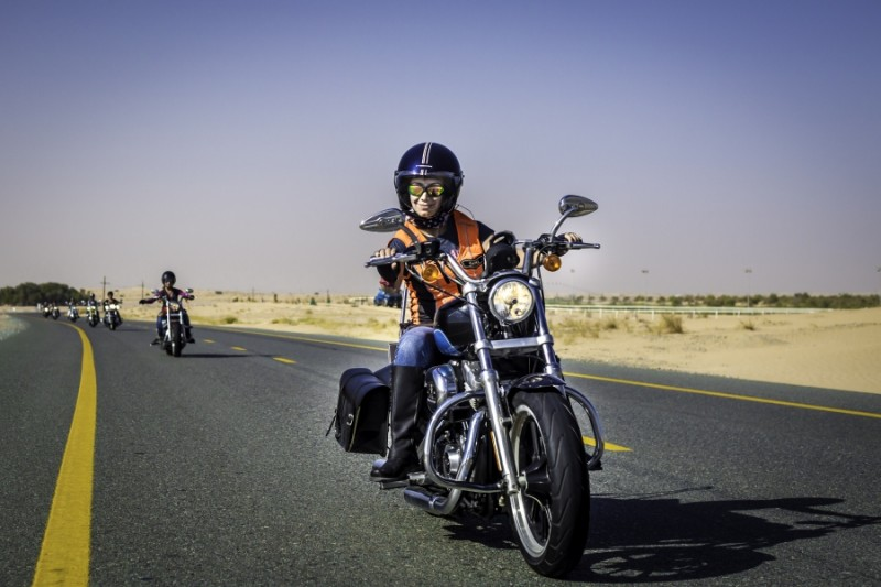 Shima Mehri leading the pack of Dubai Ladies of Harley riders on International Female Ride Day. Credit: Amanda Fisher.  Published with PRI's permission