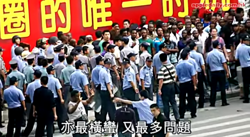 Screen capture from Apple Daily's video report on 2012 African riot in Guangzhou triggered by a suspicious death of a Nigerian during police's detention.