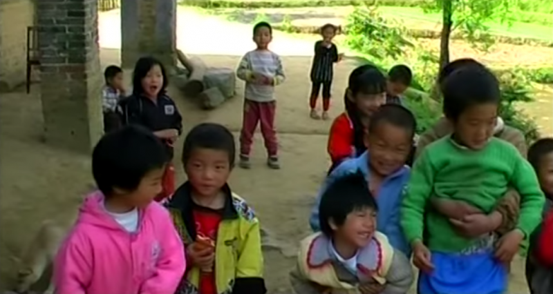 60 million children are left-behind in rural areas while their parents are working in big cities. Screen capture from a documentary on left-behind children directed by Jiang Nengjie