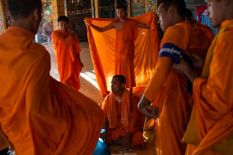 Monks get ready on day four of a ten day Human Rights march into Phnom Penh on National Road 6. After the Cambodia's general elections in July 2013, groups of Monks took an active roll in politics and promoting Human Rights. Photo and caption by Nicolas Axelrod (12/4/2013)
