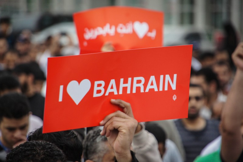 A protestor carrying a I love Bahrain placard during a rally in Bahrain in 2013. Photograph by Moh'd Saeed. Copyright: Demotix