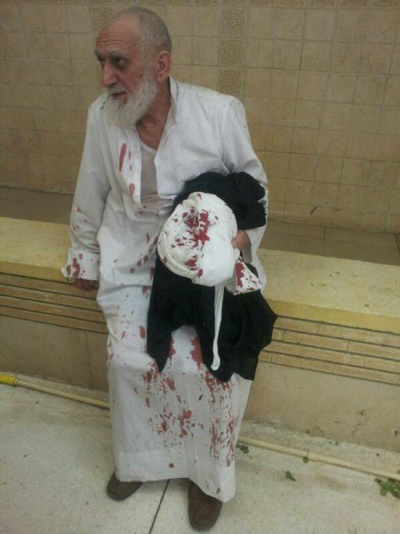 Bloodstained Shia cleric survives the suicide attack on the mosque in #Kuwait, tweets @Hayder_alKhoei
