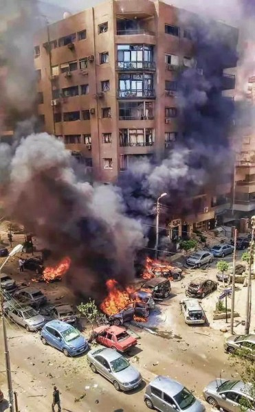 A photograph of the explosion that killed Egypt's Public Prosecutor that has gone viral on Twitter. Shared by @TheMiinz
