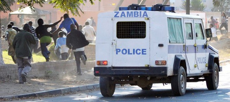 A Zambian police van carrying riot police chasing rioting students at one of the public colleges in Lusaka. Photo used with the permission of Lusaka Times.