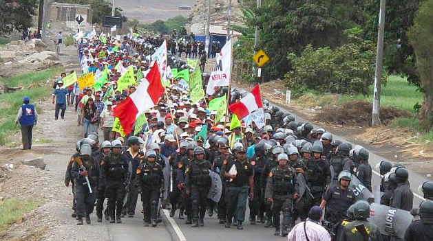 Image of one of many manifestations against Tia Maria mining project in Perú strongly watched by peruvian forces of order. Photo taken from the site of peruvian politician Rosa Maria Palacios.