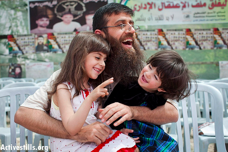 Khader Adnan plays with his daughters on his first day out of Israeli jail in the West Bank village of Araba, near Jenin, April 18, 2012. (Photo: Activestills/ Oren Ziv)