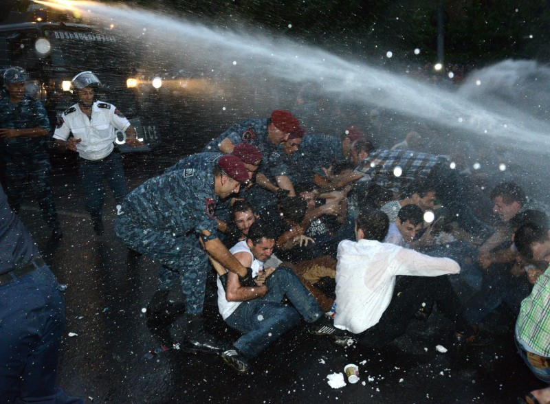 Police use water cannons to disperse demonstrations  in Yerevan on 23 June. Demotix/PHOTOLURE News Agency/7926046