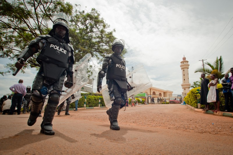 Kampala, Uganda. 27 April 2012 -- Riot police walk past the entrance to the Gaddafi National Mosque in Old Kampala. Photo by Will Boase. Copyright Demotix