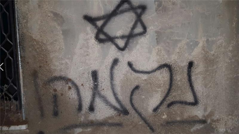 Graffiti reading 'revenge' and 'long live Messiah' were left on the walls of the burnt houses [Photo: Rabbis for Human Rights]
