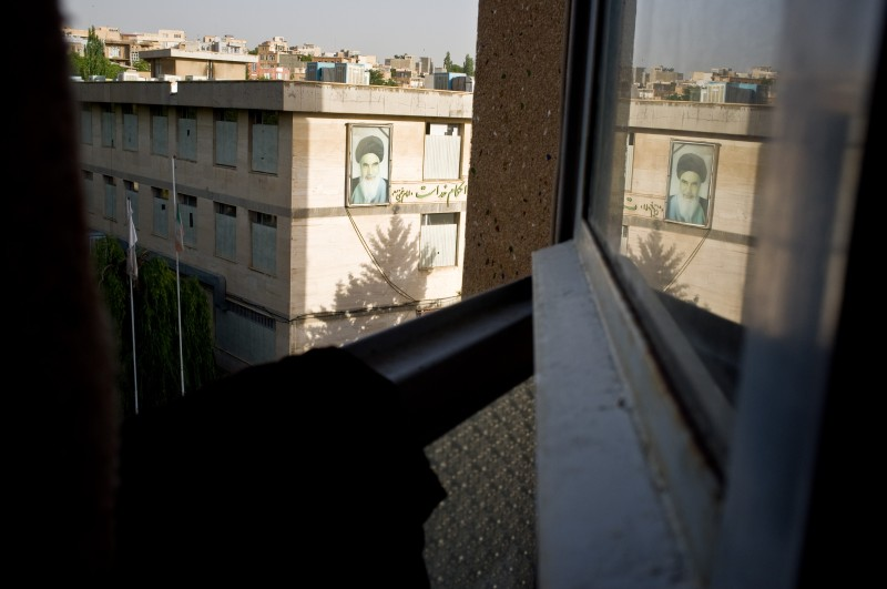 The image of the leader of the Iranian Revolution Imam Khomeini on the wall of a building in Sanandaj, in the capital of Iranian Kurdistan Province, as seen through an open window. Photo by Jordi Boixareu. Copyright Demotix