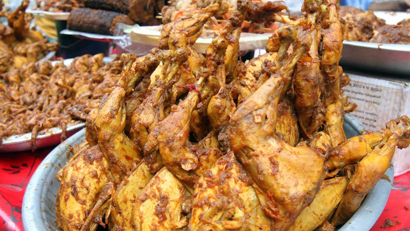 Whole chicken roasts at the Iftar market. Images by SK Hasan Ali. Copyright: Demotix (30/6/2014).