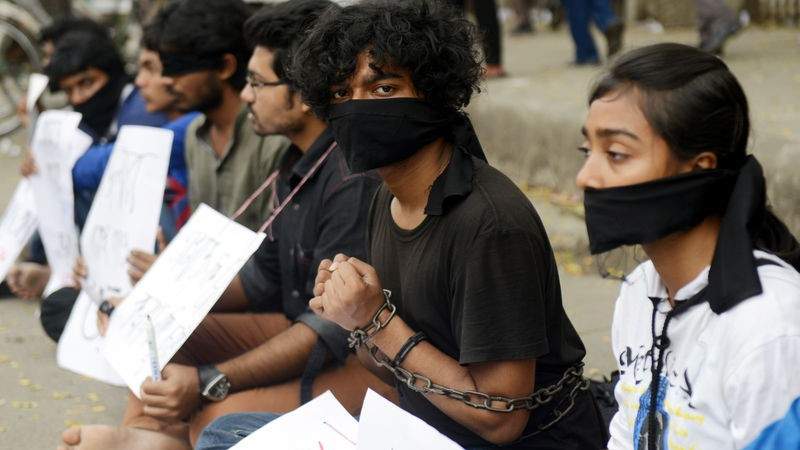 Activists engaging in a silent protest in front of the National Press Club in Bangladesh Capital Dhaka, protesting the murder of writer and blogger Avijit Roy. Image by Sourav Lasker, Copyright Demotix (1/3/2015)
