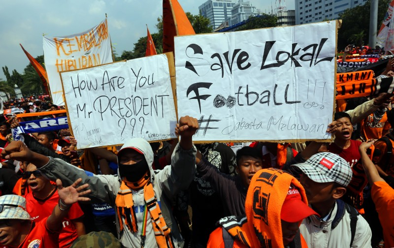 Supporters of football club Persija rally holding signs demanding presidential intervention to roll out the Indonesian Super League affected by the decision of the government to suspend the local football association (PSSI). Photo by Denny Pohan, Copyright @Demotix (5/5/2015)